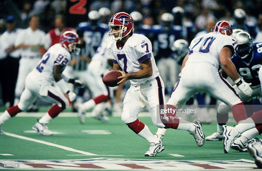 Buffalo Bills quarterback Doug Flutie hands off during a 26
