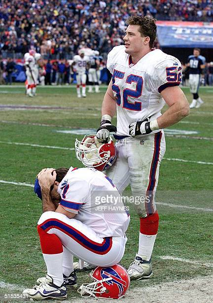 Buffalo Bills quarterback Doug Flutie sits dejected with John Holecek while waiting to hear the decision on the lateral kick-off return of the...