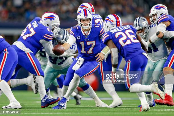 Buffalo Bills Quarterback Josh Allen hands the ball off to Running Back Devin Singletary during the game between the Buffalo Bills and Dallas Cowboys...