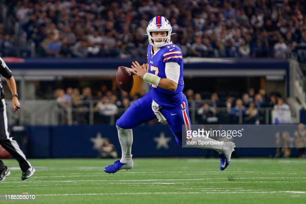 Buffalo Bills Quarterback Josh Allen rolls out of the pocket during the game between the Buffalo Bills and Dallas Cowboys on November 28, 2019 at...