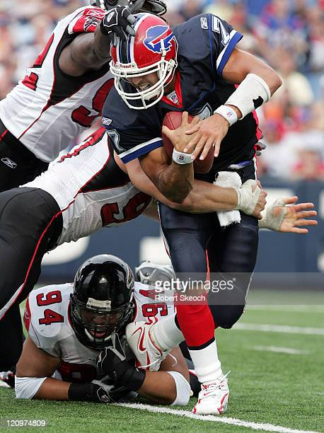 Buffalo Bills quarterback JP Losman scrambles for yards before getting sacked by Patrick Kerney and Chad Lavalais during the game against the Atlanta...