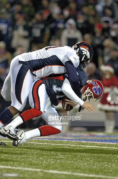 Buffalo Bills quarterback Kelly Holcomb is sacked by defensive lineman Gerald Warren during a game against the Denver Broncos at Ralph Wilson Stadium...