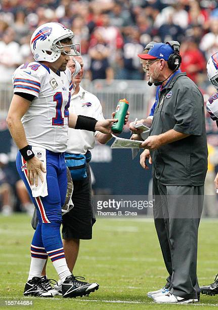 Buffalo Bills quarterback Ryan Fitzpatrick talks with head coach Chan Gailey during a timeout against the Houston Texans on November 4 2012 at...