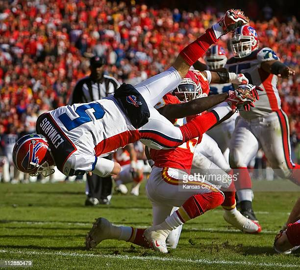 Buffalo Bills quarterback Trent Edwards dives over Kansas City Chiefs safety Bernard Pollard kneeling center during a 15yard touchdown run in the...