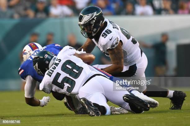Buffalo Bills quarterback Tyrod Taylor is tackled by Philadelphia Eagles middle linebacker Jordan Hicks and Philadelphia Eagles defensive end Derek...