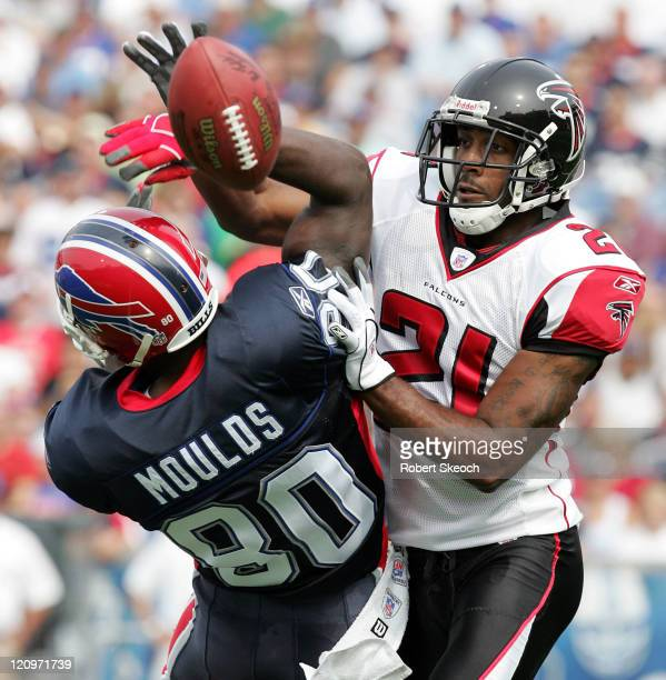Buffalo Bills receiver Eric Moulds fights for the ball with DeAngelo Hall during the game against the Atlanta Falcons at Ralph Wilson Stadium in...