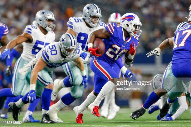 Buffalo Bills Running Back Devin Singletary breaks free of a tackle attempt by Dallas Cowboys Linebacker Sean Lee during the game between the Buffalo...