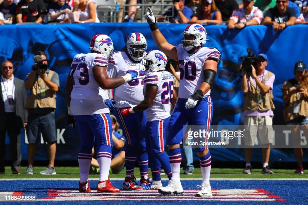 Buffalo Bills running back Devin Singletary celebrates with teammates after scoring during the second quarter of the National Football League game...