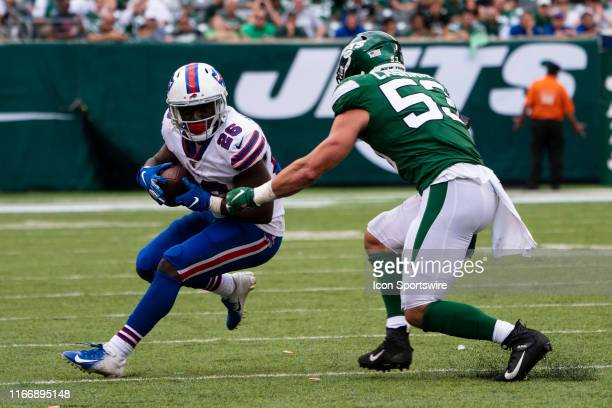 Buffalo Bills Running Back Devin Singletary makes a catch and is tackled by New York Jets Linebacker Blake Cashman during the second half of the game...