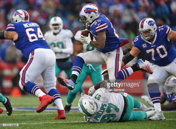 Buffalo Bills running back LeSean McCoy jumps over Miami Dolphins defensive tackle Jordan Phillips in the fourth quarter on Sunday Dec 17 2017 at New...