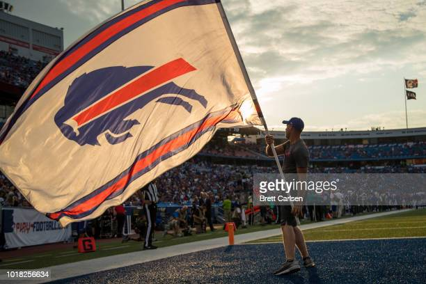Buffalo Bills spirit member waives a flag to celebrate a score during the first half of a preseason game against the Carolina Panthers at New Era...