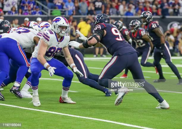Buffalo Bills tight end Dawson Knox prepares to block Houston Texans defensive end J.J. Watt in the second quarter of the AFC Wild Card football game...