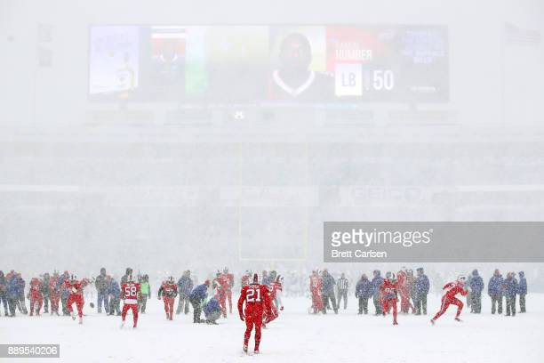 Buffalo Bills warm up in the snow before a game against the Indianapolis Colts on December 10 2017 at New Era Field in Orchard Park New York
