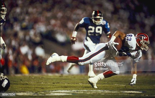Buffalo Bills wide receiver Andre Reed attempts to gain yardage in a 2019 loss to the New York Giants in Super Bowl XXV on January 27 1991 at...