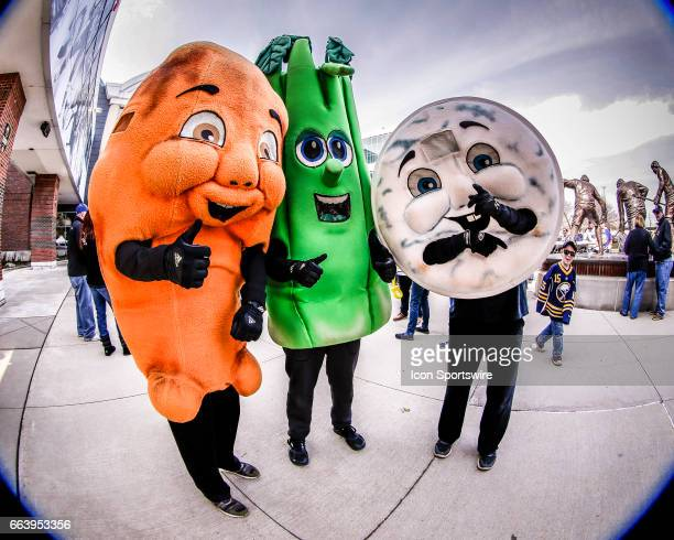 Buffalo Bison mascots the Buffalo Wing Celery Stalk and Bleu Cheese Dressing look on during pregame ceremonies prior to the New York Islanders and...