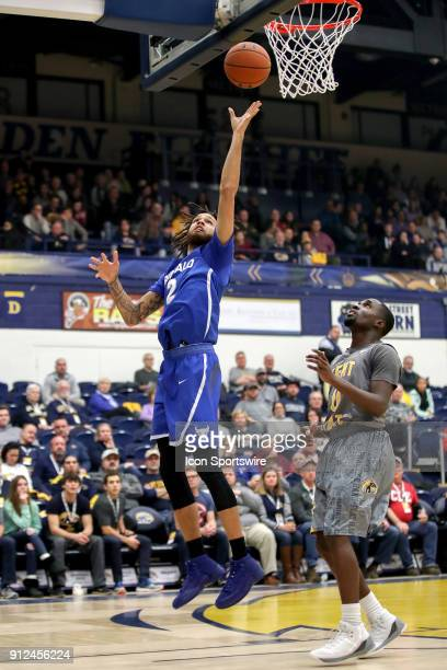 Buffalo Bulls forward Jeremy Harris scores with a layup against Kent State Golden Flashes guard Jalen Avery defends during the first half of the...