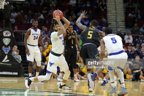 Buffalo Bulls forward Jeremy Harris steps the ball from Kent State Golden Flashes forward Danny Pippen during the second half of the MAC Mens...