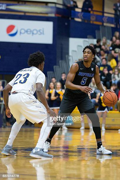 Buffalo Bulls G CJ Massinburg is defended by Kent State Golden Flashes G Jaylin Walker during the first half of the NCAA Men's Basketball game...