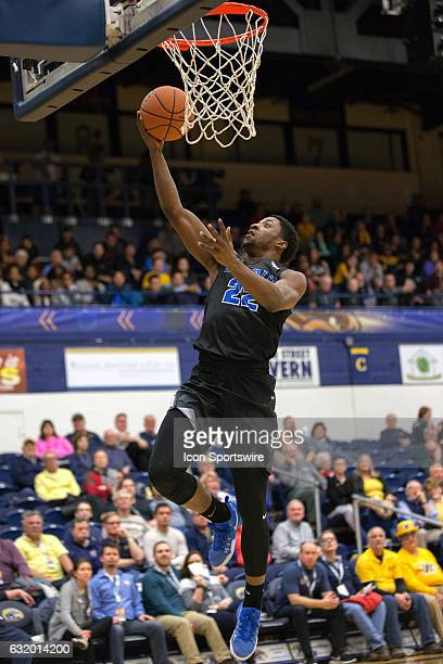 Buffalo Bulls G Dontay Caruthers scores with a layup during the first half of the NCAA Men's Basketball game between the Buffalo Bulls and Kent State...