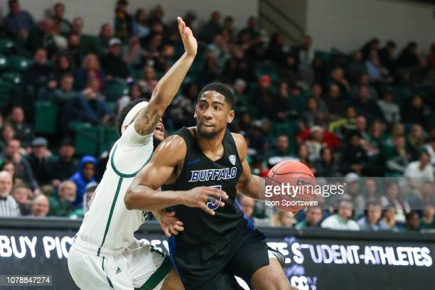 Buffalo Bulls guard CJ Massinburg drives to the basket against Eastern Michigan Eagles guard Malik Ellison during a regular season MidAmerican...