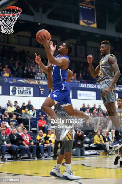 Buffalo Bulls guard CJ Massinburg drives to the basket as Kent State Golden Flashes center Adonis De La Rosa and Kent State Golden Flashes forward...
