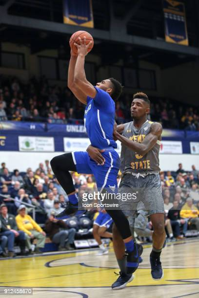 Buffalo Bulls guard Jayvon Graves is fouled by Kent State Golden Flashes forward Danny Pippen as he scores on a fast break during the first half of...