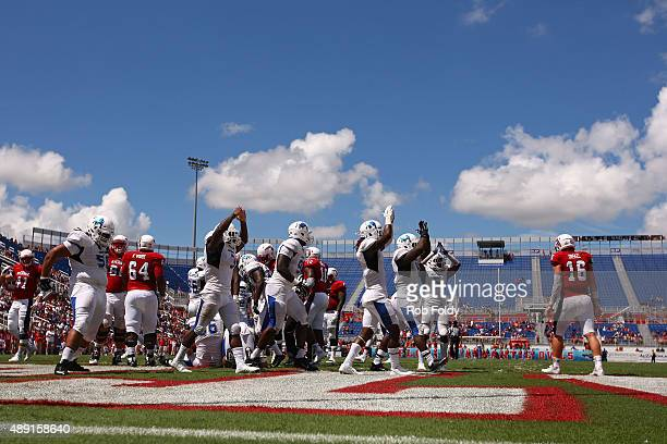Buffalo Bulls players signal for a safety during the second half of the game against the Buffalo Bulls at FAU Stadium on September 19 2015 in Boca...