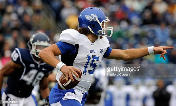 Buffalo Bulls quarterback Alex Zordich directs his offensive line where to block against Connecticut at Rentschler Field in East Hartford Connecticut...