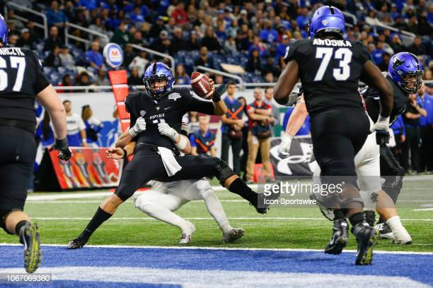 Buffalo Bulls quarterback Tyree Jackson is sacked by Northern Illinois Huskies defensive end Sutton Smith during the MidAmerican Conference...
