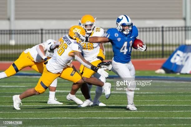 Buffalo Bulls Running Back Jaret Patterson runs with the ball past Kent State Golden Flashers Defensive Back Richie Carpenter Jr. For a touchdown...