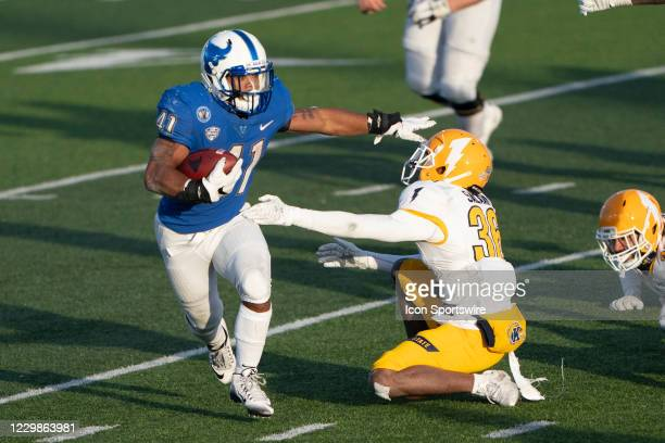 Buffalo Bulls Running Back Jaret Patterson runs with the ball past Kent State Golden Flashers Safety Jeremiah Salaam during the second half of the...