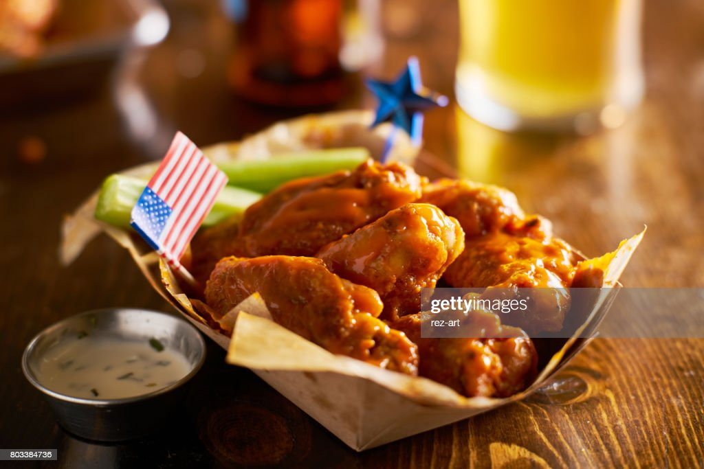 buffalo chicken wings with patriotic 4th of july theme and american flag : Stock Photo