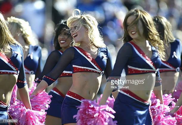 Buffalo Jills cheerleaders dance during a timeout between the Buffalo Bills and Baltimore Ravens on October 21 2007 at Ralph Wilson Stadium in...