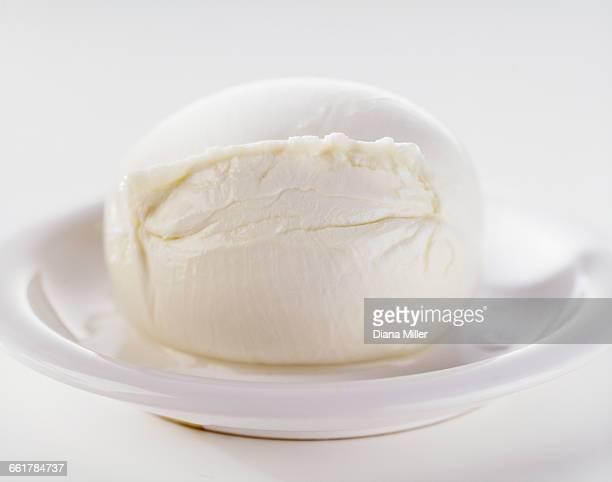 Buffalo mozzarella, on white dish, close-up