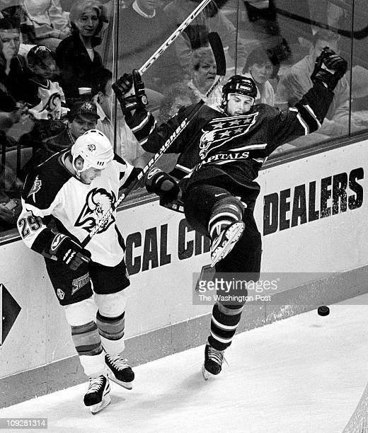 6/4/98 Buffalo NY USA NHL SemiFinals Game Six Caps vs Sabers CAPTIONS Caps Brendan Witt is off balance after being hit by Buffalo's Vaclav Varada in...