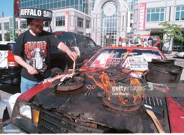 Buffalo NYSuper sabres fan Ken Johnson holds the ultimate tailgate party on the hood of his 1989 Ford Pintoas you can see the car car often catches...
