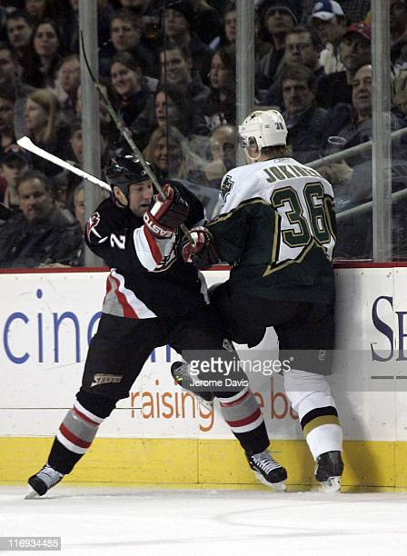 Buffalo Sabres' Adam Mair checks Stars' Jussi Jokinen during a game versus the Dallas Stars at the HSBC Arena in Buffalo, NY, December 14, 2005....
