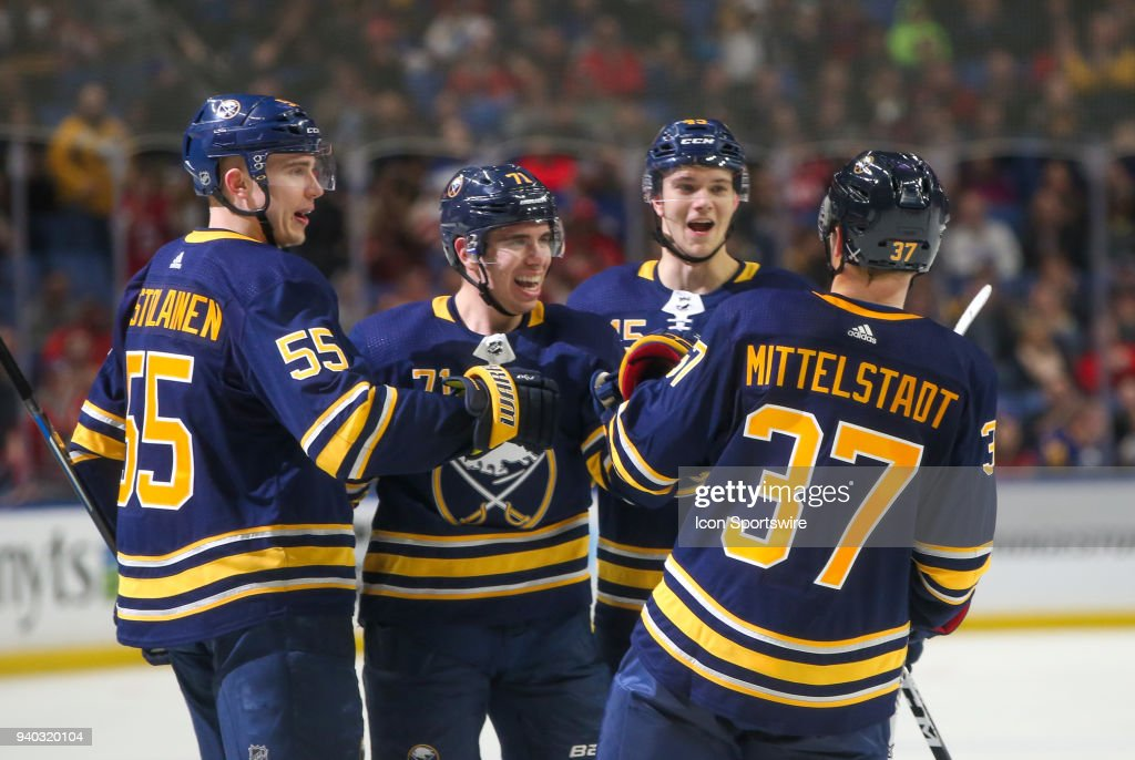 Buffalo Sabres center Casey Mittelstadt (37) is congratulated by teammates Buffalo Sabres defenseman Rasmus Ristolainen (55), Buffalo Sabres defenseman Brendan Guhle (45), and Buffalo Sabres left wing Evan Rodrigues (71) after Mittelstadt assisted on Evan Rodrigues (71) goal in third period during an NHL game between the Detroit Red Wings and Buffalo Sabres on March 29, 2018 at the KeyBank Center in Buffalo, NY.