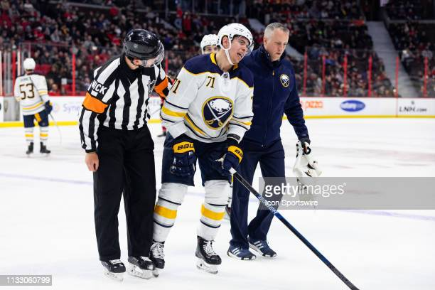 Buffalo Sabres Center Evan Rodrigues is helped off the ice hurt during second period National Hockey League action between the Buffalo Sabres and...