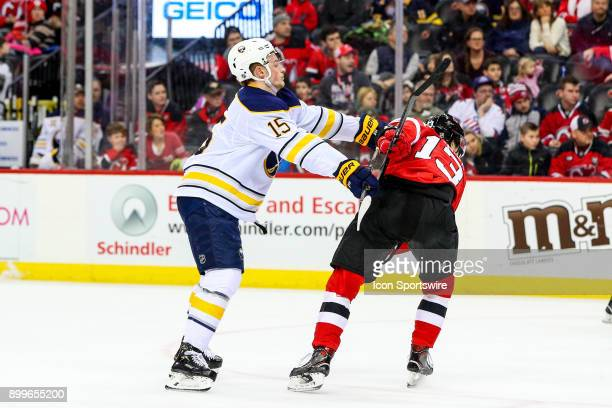 Buffalo Sabres center Jack Eichel hits New Jersey Devils center Nico Hischier during the third period of the National Hockey League Game between the...