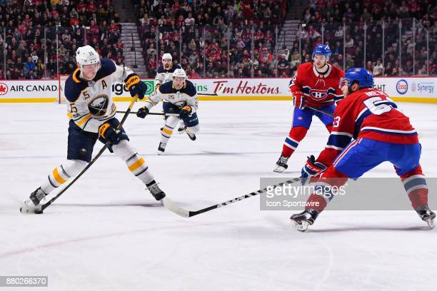 Buffalo Sabres Center Jack Eichel shoots the puck facing Montreal Canadiens Defenceman Victor Mete during the Buffalo Sabres versus the Montreal...