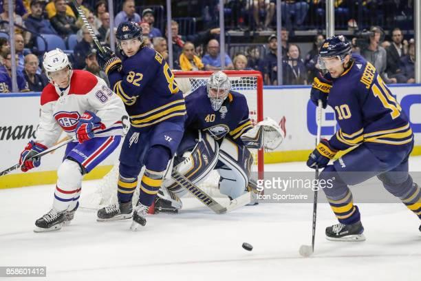 Buffalo Sabres Center Jacob Josefson prepares to clear puck as Montreal Canadiens Right Wing Ales Hemsky Buffalo Sabres Defenseman Nathan Beaulieu...