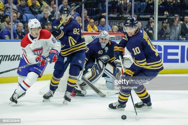 Buffalo Sabres Center Jacob Josefson tries to clear puck as Montreal Canadiens Right Wing Ales Hemsky and Buffalo Sabres Defenseman Nathan Beaulieu...