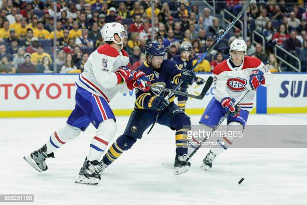 Buffalo Sabres Center Johan Larsson is checked by Montreal Canadiens Defenseman Shea Weber as Montreal Canadiens Right Wing Ales Hemsky moves in...
