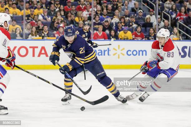 Buffalo Sabres Center Johan Larsson tries to control puck as Montreal Canadiens Defenseman Shea Weber and Montreal Canadiens Right Wing Ales Hemsky...