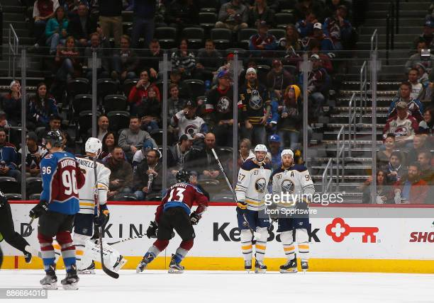 Buffalo Sabres center Ryan O'Reilly and Buffalo Sabres left wing Benoit Pouliot celebrate a goal by Pouliot during a regular season game between the...