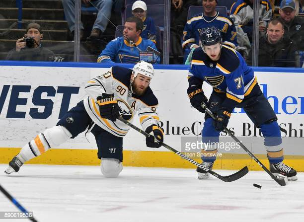 Buffalo Sabres center Ryan OReilly and St Louis Blues left wing Vladimir Sobotka compete for the puck during a NHL game between the Buffalo Sabres...