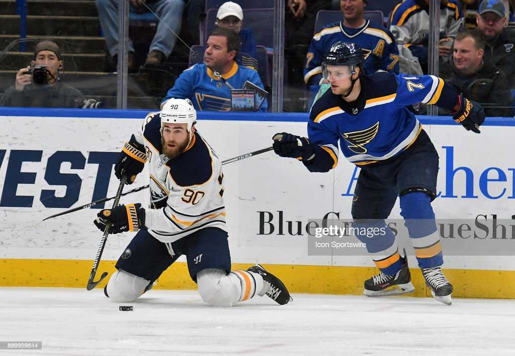 Buffalo Sabres center Ryan O?Reilly (90) falls to his knees ahead of St. Louis Blues left wing Vladimir Sobotka (71) as he goes for the puck during a NHL game between the Buffalo Sabres and the St. Louis Blues on December 10, 2017, at Scottrade Center, St. Louis, MO. St/ Louis won in overtime, 3-2.
