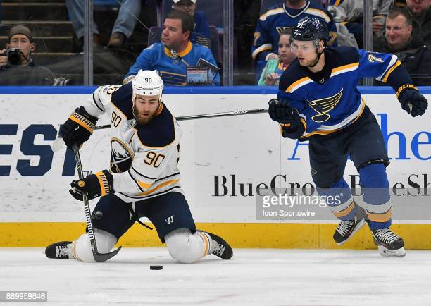Buffalo Sabres center Ryan OReilly falls to his knees as he plays the puck ahead of St Louis Blues left wing Vladimir Sobotka during a NHL game...