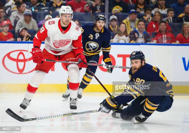 Buffalo Sabres center Ryan O'Reilly tries to block th e pass of Detroit Red Wings right wing Anthony Mantha during an NHL game between the Detroit...